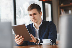 Business man with tablet computer in cafe Royalty Free Stock Photography