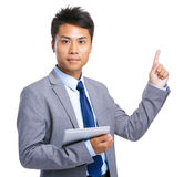 Business man with tablet and finger point up Stock Images