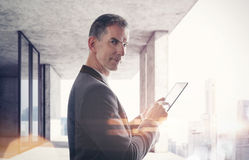 Business man with tablet Stock Photos