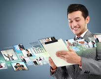 Business man with tablet Royalty Free Stock Photography