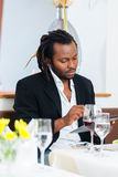 Business man with tablet in restaurant Stock Photography