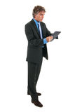 Business man with tablet in studio Stock Photo