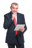 Business man with tablet is thinking Royalty Free Stock Images