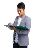 Business man take note on clipboard Stock Image