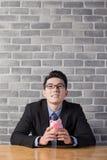 Business man take piggy bank Royalty Free Stock Image