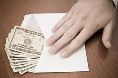 Business man take a stack of money in envelope Stock Photography