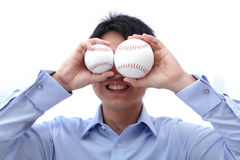 Business man take two ball on the face Royalty Free Stock Images