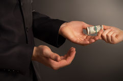 Business man takes a bribe Royalty Free Stock Image