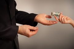 Business man takes a bribe Royalty Free Stock Photos