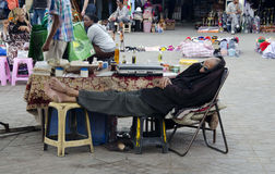 Business man taking a midday nap in Marakesh, Turkey royalty free stock photo