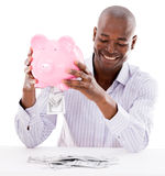 Business man taking money from his savings Stock Photo