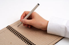 Business man taking notes. With pen and note pad Royalty Free Stock Photography