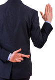 Businessman taking oath. Business man taking oath with fingers crossed Stock Image