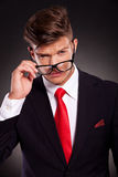 Business man taking off eyeglasses Royalty Free Stock Photography