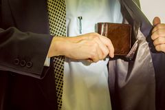 Wallet in Hand. A business man taking out his wallet from suit pocket Royalty Free Stock Photos