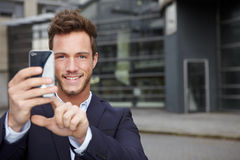 Business man taking pictures Royalty Free Stock Image