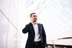 Business man talk on phone in big office Royalty Free Stock Photos