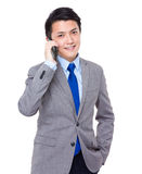 Business man talk to cellphone Stock Image