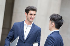 Business man talk and walk Stock Image