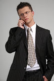 Business man talking. On a mobile phone in a black suit Royalty Free Stock Photo