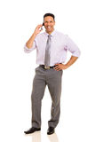 Business man talking. Cheerful business man talking on cell phone Royalty Free Stock Image