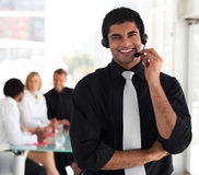 Business man talking on a headset. Young Businessman talking on a headset Royalty Free Stock Photo