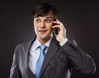 Business man talking on his cellphone Royalty Free Stock Photos