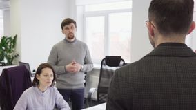 Business man talking with his colleagues in office stock video footage