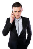 Business man talking on his mobile phone Royalty Free Stock Photos