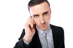 Business man talking on his mobile phone. Over white background Royalty Free Stock Image
