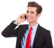 Business man talking on his smartphone Stock Photos