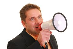 Business man talking into a megaphone Stock Photography