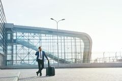 Business Man Talking On Mobile Phone Outdoors. Man With Suitcase Traveling On Business Trip. High Resolution Royalty Free Stock Photos