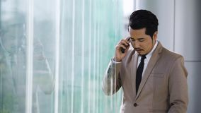 Business man talking on mobile phone. Young business man talking on mobile phone stock video footage