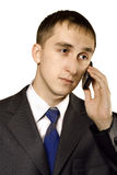 Business man talking on a mobile telephone. Isolated Stock Photography