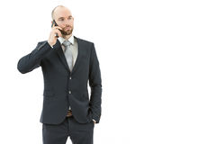 Business man talking on the phone. Caucasian young business man talking on the phone. Isolated on white background Stock Photography