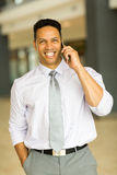 Business man talking on phone. Handsome business man talking on mobile phone in office building Royalty Free Stock Photo