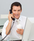 Business man talking on phone in the office Stock Image