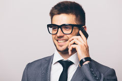 Business man talking on phone on white. Portrait of young business man talking on phone on white Royalty Free Stock Photography