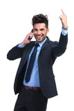 Business man talking at the phone and winning Royalty Free Stock Photography