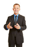 Business man talking during presentation Stock Photography
