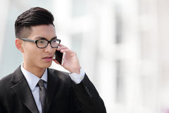 Business man talking on smart phone. In the city Royalty Free Stock Photos