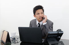 Business man talking telephone in office Royalty Free Stock Photo