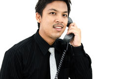 Business man talking telephone in white background.  Royalty Free Stock Photo