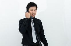 Business man talking telephone in white background.  Stock Photos