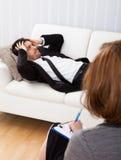 Business man talking to his psychiatrist explaining something Royalty Free Stock Photos