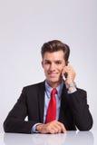 Business man talks on phone Royalty Free Stock Photos