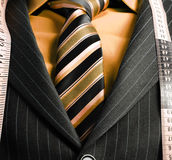 Business man with tape measure Stock Images