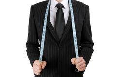 Business man with tape measure Royalty Free Stock Image
