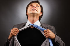 Business man tearing off his shirt Royalty Free Stock Photo